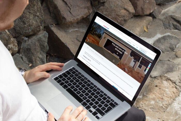Man viewing Checkatrade article on his laptop